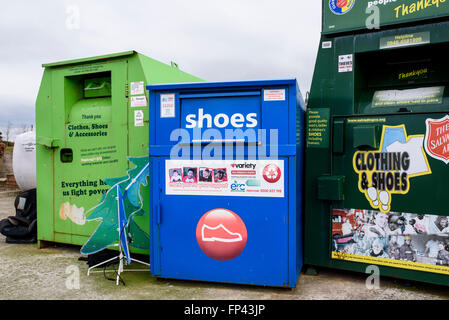 Clothes and Shoe Bank recycling containers in the car park of a Tesco supermarket in Blackpool, Lancashire - Stock Photo