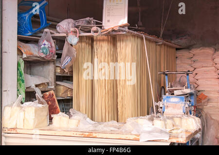 Fresh handmade noodles for sale in a traditional market of Kunming in China - Stock Photo