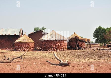 Round brick huts near Grottes de Nok in Togo in rural Western Africa - Stock Photo