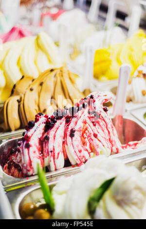 classic italian gourmet gelato gelatto ice cream display in shop - Stock Photo