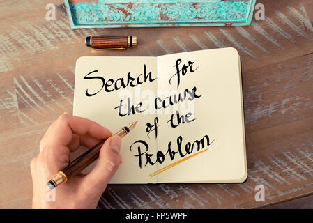 Retro effect and toned image of a woman hand writing a note with a fountain pen on a notebook. Handwritten text - Stock Photo