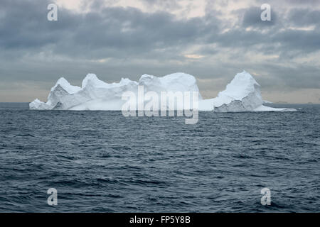 Huge Tabular Iceberg floating in Bransfield Strait near the northern tip of the Antarctic Peninsula, Antarctica - Stock Photo