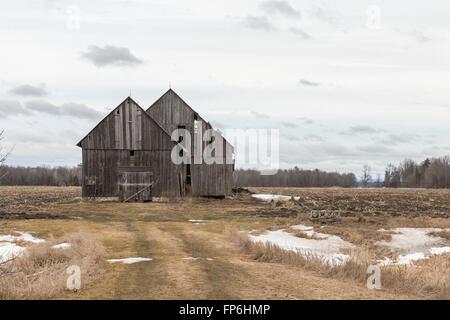 Decrepit building in a farmers field - Stock Photo