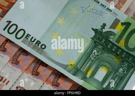 100 euro banknote on 5000 russian roubles - Stock Photo