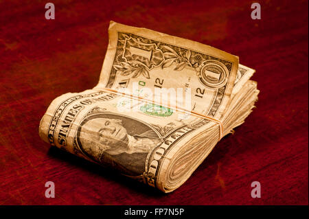 Very Worn Dollar Bills With Rubber Band - Stock Photo