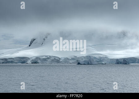 Heavy cloud system over the coastline of Neko Harbor, Andvord Bay, Antarctic Peninsula. Among the most beautiful - Stock Photo