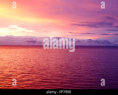 Sunrise over Brabant Island, Gerlache Strait, Antarctica. Brabant island is the second largest island in the Palmer - Stock Photo