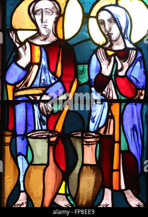 Wedding at Cana, stained glass window in Basilica of St. Vitus in Ellwangen, Germany - Stock Photo