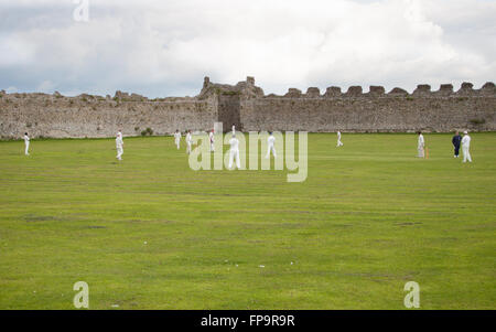 Cricket practice within the grounds of Portchester Castle, Portsmouth, Hampshire - Stock Photo