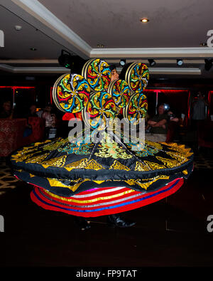 An Egyptian Sufi, Whirling dervish, performing on board a Nile Cruise ship - Stock Photo