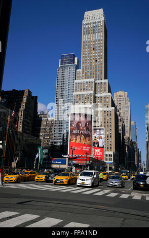 Yellow cabs and cars on 7th Avenue. New York City, USA - Stock Photo