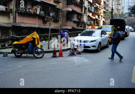 Chongqing, CHINA. 17th Mar, 2016. March 17 2016: (EDITORIAL USE ONLY. CHINA OUT) It's an old community so no parking - Stock Photo