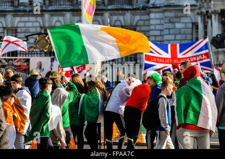 Belfast, Northern Ireland, UK. 17 Mar 2016. Nationalist youths hold up tricolours, some with 'IRA' written on them, - Stock Photo