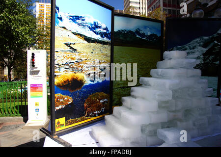 La Paz, Bolivia, 18th March 2016. Blocks of ice melt in front of photos of Bolivia's mountains at an event organised - Stock Photo