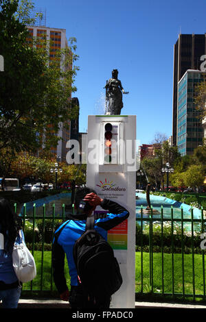 La Paz, Bolivia, 18th March 2016. A teenager looks at a radiation meter showing red / high solar UV levels. The - Stock Photo