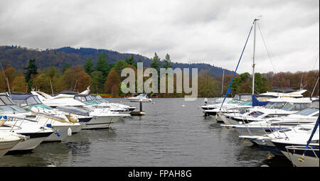 Yachts, moror boats, vessels at anchor on lake windermere, lake district, UK in winter - Stock Photo