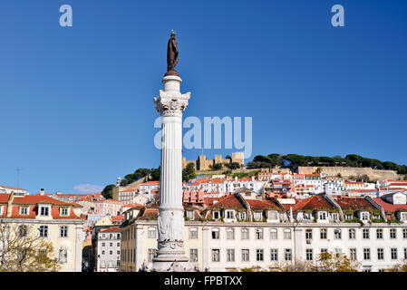 Portugal, Lisbon: Column and statue of Dom Pedro IV at Rossio Square with castle in the background - Stock Photo