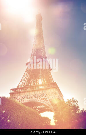 Low angle close up view of the Eiffel Tower, Paris, France on a sunny day showing the wrought iron lattice structure, - Stock Photo