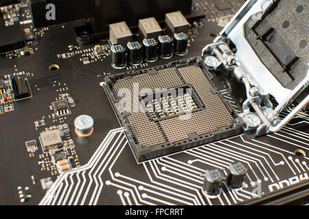 Computer Motherboard with empty and open CPU socket - Stock Photo