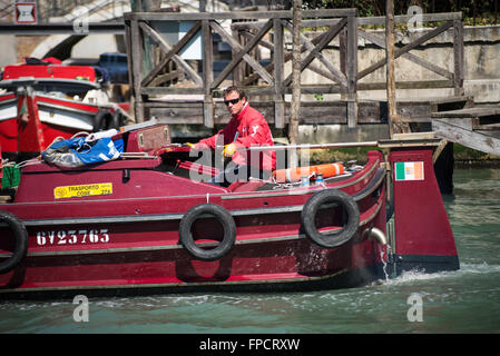Portrait of a skipper of a barge on the Grand Canal in Venice on a sunny spring afternoon - Stock Photo
