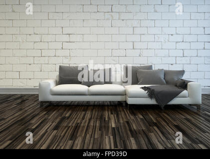 Rustic living room interior with a large white sofa with grey cushions on a bare wooden parquet floor against a - Stock Photo