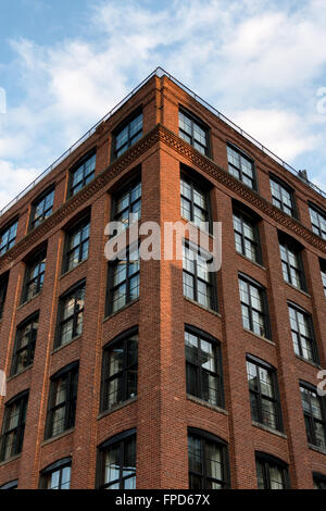 ... Low Angle View Of Tall Brick Apartment Building With Beautiful Blue Sky  And Clouds Reflecting In Part 11