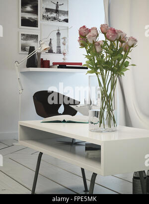 Small office area in a modern apartment with a table, chair and shelving with artwork on the white wall, tiled white - Stock Photo