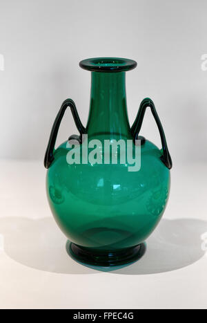 Murano, Venice green glass vase with two angled handles from this Venetian Island famous for its history of glass - Stock Photo