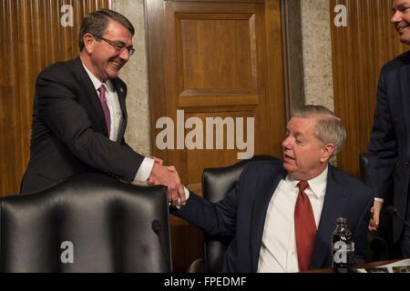 U.S Senator Lindsey Graham of South Carolina greets Secretary of Defense Ashton Carter before hearings in the Senate - Stock Photo