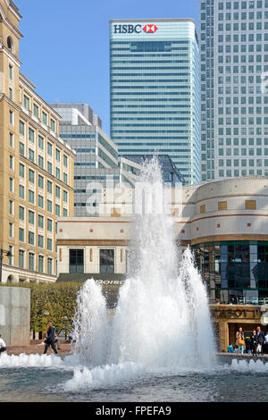 Water fountain feature in Cabot Square at Canary Wharf East London Docklands Tower Hamlets England UK with HSBC - Stock Photo