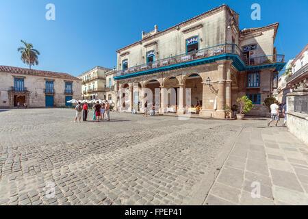 HAVANA, CUBA   APRIL 2, 2012: Tourist Walking Near El Patio Restaurant In
