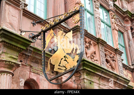 Detail of Sign Featuring Golden Rider on Horseback on Exterior of Historic Hotel Zum Ritter in Heidelberg, Baden - Stock Photo