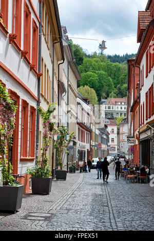 View of Picturesque Cobblestone Street Lined with Colorful Buildings in Heidelberg, Baden-Wurttemberg, Germany - Stock Photo