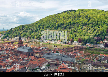 Overview of Old Bridge Spanning Neckar River Between Old and New Towns of Heidelberg in Green Hills of Baden-Wurttemberg, - Stock Photo