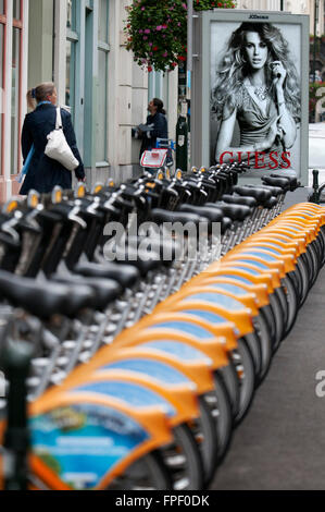 Municipal rental bikes in the center of Brussels, Belgium. Increasingly reserved areas on the tarmac of Brussels - Stock Photo