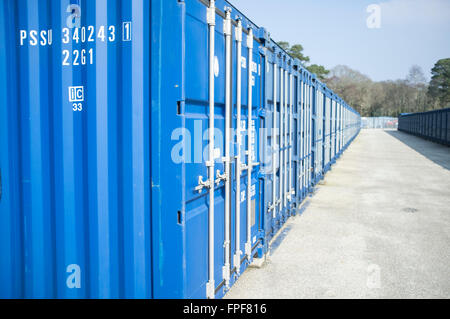 A row of blue storage containers. - Stock Photo