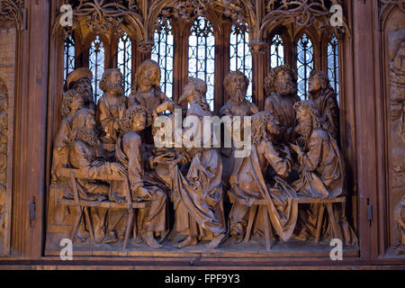 Last Supper. Central panel of the Holy Blood Altarpiece (1500-1505) by German sculptor Tilman Riemenschneider in - Stock Photo