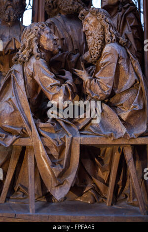 Last Supper. Detail of the central panel of the Holy Blood Altarpiece (1500-1505) by German sculptor Tilman Riemenschneider - Stock Photo