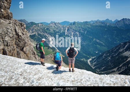HOCHVOGEL, GERmanY - 05 JULY: Climbers on top of the Kalter Winkel upfold, looking over a rocky ledge at the mountain - Stock Photo