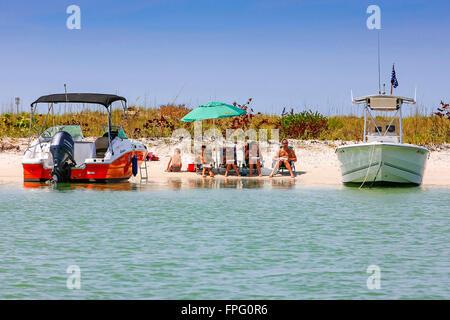 People and their boats having fun in the sun around Keewaydin Island near Naples, Florida - Stock Photo