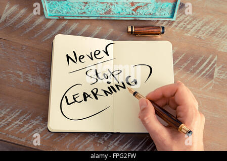 Handwritten text NEVER STOP LEARNING, business success concept - Stock Photo