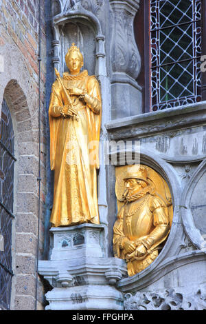 Golden statues on the facade of the Basilica of the Holy Blood in Bruges, Belgium - Stock Photo