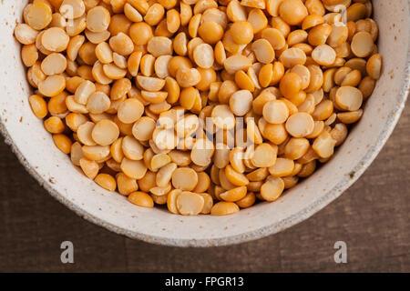 Yellow split peas used to make split pea soup and pease pudding - Stock Photo