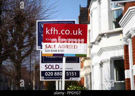 Estate agents boards in North London - Stock Photo