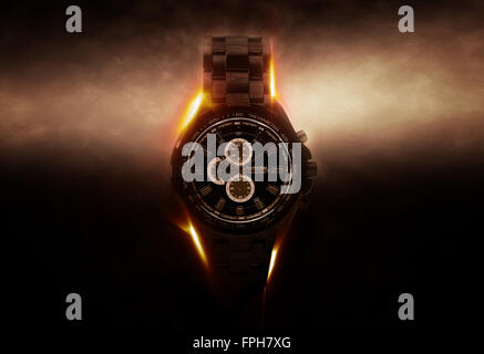 Luxury Design Black Wristwatch Chronograph Lit Dramatically from Side on Dark Background with Glowing Effect - Stock Photo