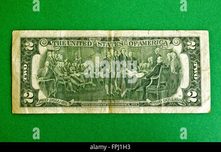 The backside of this much-used U.S. Two Dollar bill is an engraving of 'The Declaration of Independence,' an 1817 - Stock Photo