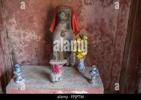 Hoi An,Vietnam Shrine to the sacred Dog at one end of the Japanese Covered Bridge, this being the year the bridge - Stock Photo