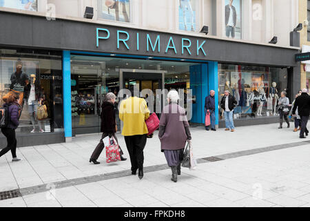Shoppers outside the entrance of a Primark store on Queen Street in Cardiff City Centre Wales UK  KATHY DEWITT - Stock Photo
