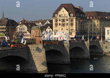 Basel, Switzerland. 19th March, 2016. A tram crossing Middle Bridge (Mittlerebrücke) during Basel World Watch and - Stock Photo