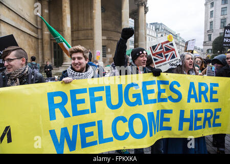 London, UK. 19th March, 2016. Anti-racist campaigners behind a 'Refugees Are Welcome Here' banner before the Stand - Stock Photo